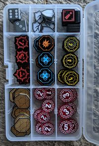 Tokens stored in a plastic bead box